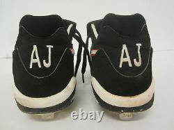 Andruw Jones Atlanta Braves signed game used baseball cleats with inscriptions COA
