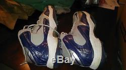 Tyron Smith Game Used Gloves and Cleats Autographed Dallas Cowboys